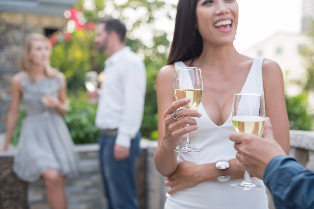 Beautiful smiling woman with glass of champagne